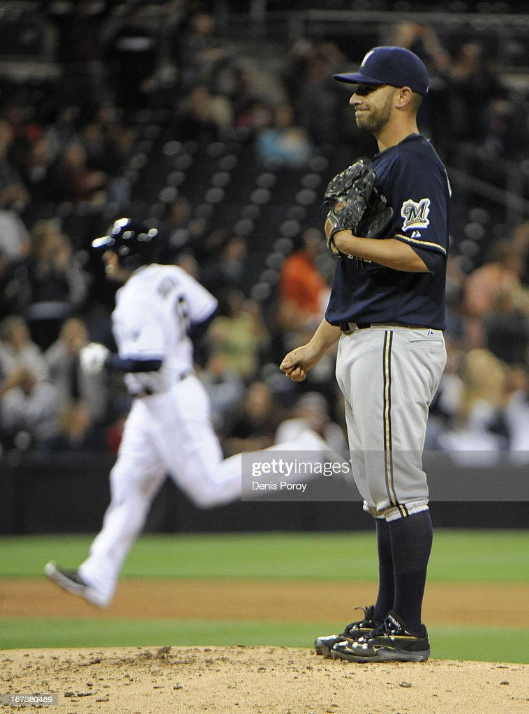 Marco Estrada #41 of the Milwaukee Brewers looks at the plate as Carlos Quentin #18 of the San Diego Padres rounds the bases after hitting a solo home run during the fourth inning of a baseball game at Petco Park on April 24, 2013 in San Diego, California.