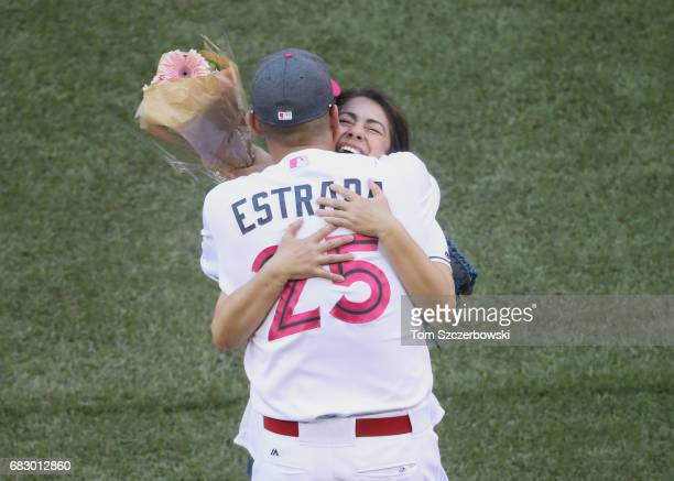 Marco Estrada of the Toronto Blue Jays hugs his mother Mariza Estrada after she threw out the first pitch before the start of MLB game action against...