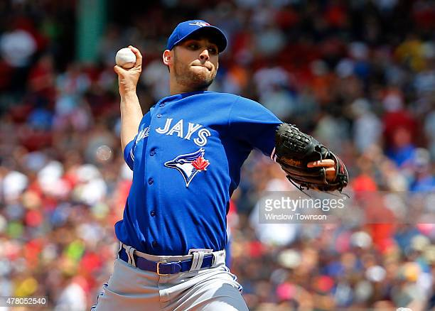 Marco Estrada of the Toronto Blue Jays pitches against the Boston Red Sox during the first inning of the game at Fenway Park on June 14 2015 in...