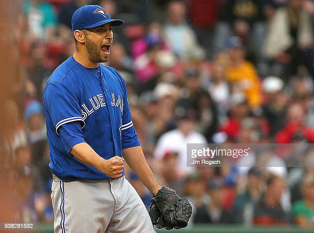 Marco Estrada of the Toronto Blue Jays reacts against the Boston Red Sox after the final out in the seventh inning without giving up a run at Fenway...