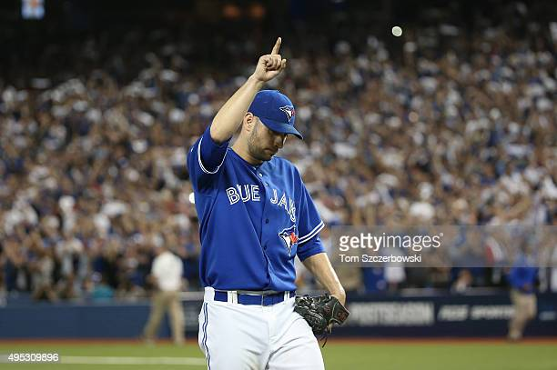 Marco Estrada of the Toronto Blue Jays salutes the fans as he exits the game after being relieved in the eighth inning against the Kansas City Royals...