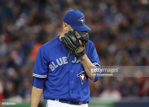 Marco Estrada of the Toronto Blue Jays walks off the mound after getting the last out of the fifth inning during MLB game action against the Boston...