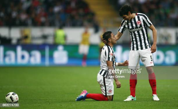 Marco Fabian and Jesus Vallejo of Frankfurt react during the Bundesliga match between Eintracht Frankfurt and Borussia Moenchengladbach at...