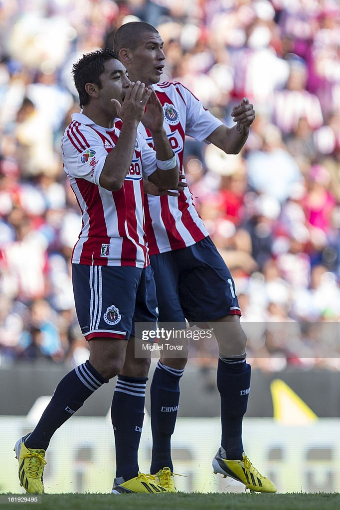 Marco Fabian and Jorge Enriquez of Chivas react during a match between Puebla and Chivas as part of the Clausura 2013 at Cuauhtemoc Stadium on February 17, 2013 in Puebla, Mexico.