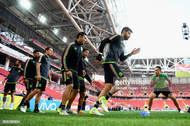 Marco Fabian and Nestor Araujo warm up during the Mexico training session on July 1 2017 in Moscow Russia