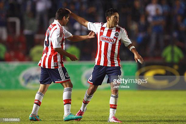 Marco Fabian de la Mora of Chivas celebrates a scored goal during a match against Queretaro as part of the 2012 Liga MX at Corregidora Stadium on...