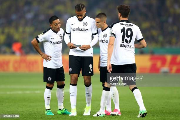 Marco Fabian Michael Hector Mijat Gacinovic and David Abraham of Frankfurt look on during the DFB Cup final match between Eintracht Frankfurt and...