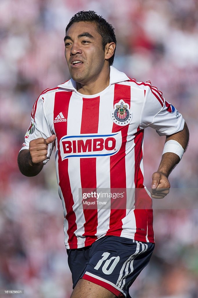 <a gi-track='captionPersonalityLinkClicked' href=/galleries/search?phrase=Marco+Fabian&family=editorial&specificpeople=5477014 ng-click='$event.stopPropagation()'>Marco Fabian</a> of Chivas celebrates a goal against Puebla during a match between Puebla and Chivas as part of the Clausura 2013 at Cuauhtemoc Stadium on February 17, 2013 in Puebla, Mexico.