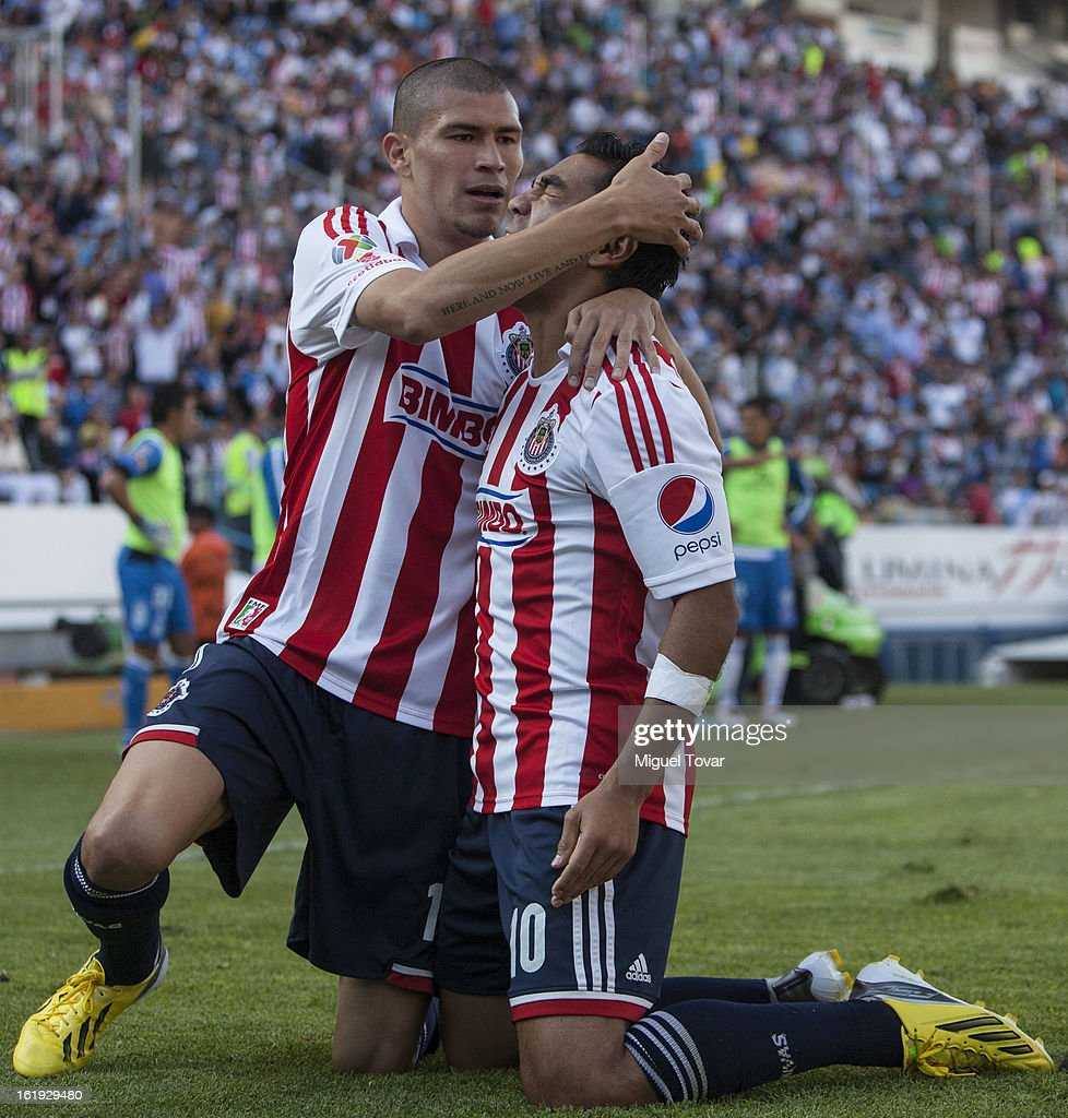 Marco Fabian of Chivas celebrates after scoring with Jorge Enriquez during a match between Puebla and Chivas as part of the Clausura 2013 at Cuauhtemoc Stadium on February 17, 2013 in Puebla, Mexico.