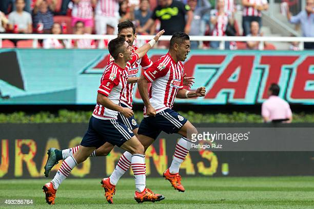 Marco Fabian of Chivas celebrates with his teammates after scoring the first goal of his team during the 13th round match between Chivas and Puebla...
