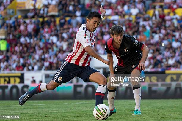 Marco Fabian of Chivas kicks the ball to score during a quarterfinal second leg match between Atlas and Chivas as part of Clausura 2015 Liga MX at...