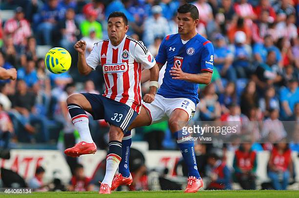 Marco Fabian of Chivas struggles for the ball with Francisco Rodriguez of Cruz Azul during a match between Cruz Azul and Chivas as part of 7th round...