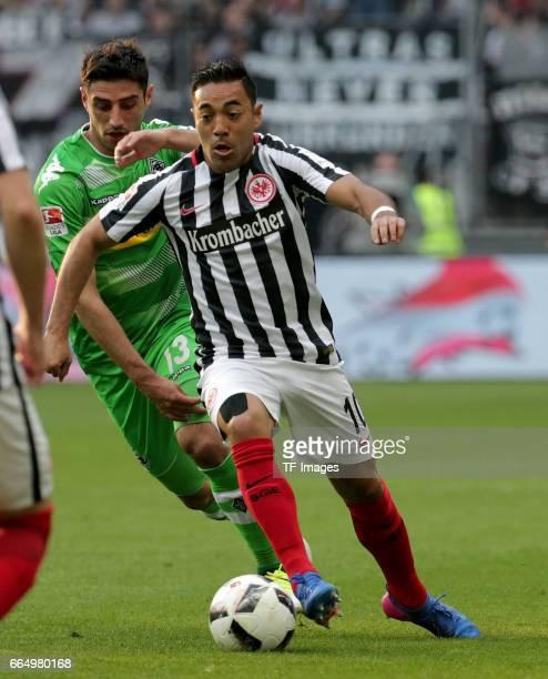 Marco Fabian of Frankfurt and Lars Stindl of Mönchengladbach battle for the ball during the Bundesliga Match between Eintracht Frankfurt and Borussia...