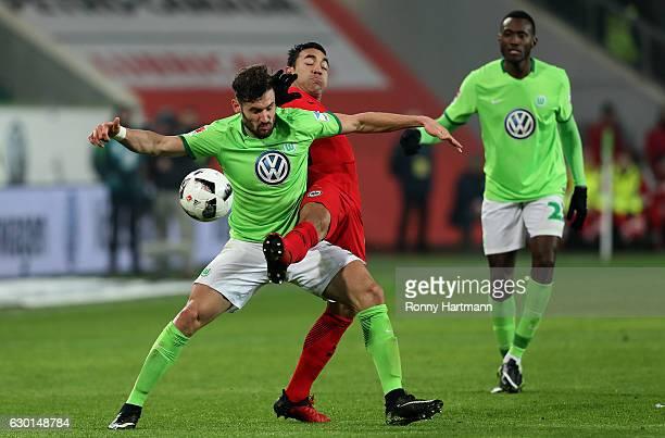 Marco Fabian of Frankfurt competes with and Daniel Caligiuri of Wolfsburg during the Bundesliga match between VfL Wolfsburg and Eintracht Frankfurt...