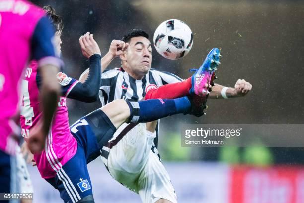 Marco Fabian of Frankfurt is challenged by Gotoku Sakai of Hamburg during the Bundesliga match between Eintracht Frankfurt and Hamburger SV at...