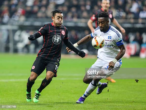 Marco Fabian of Frankfurt is challenged by Johan Djourou of Hamburg during the Bundesliga match between Eintracht Frankfurt and Hamburger SV at...