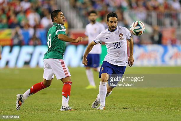 Marco Fabian of Mexico and Ruben Amorim of Portugal