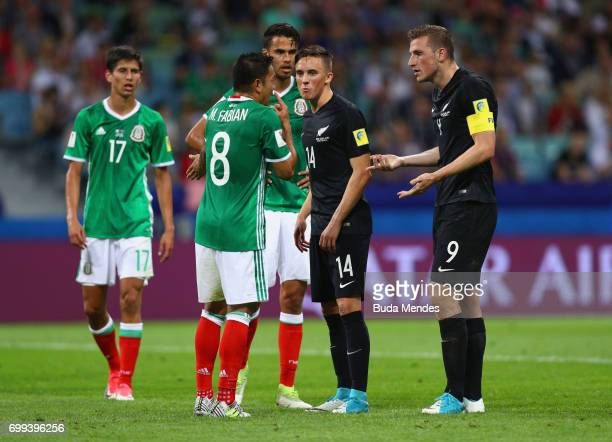 Marco Fabian of Mexico argues with Ryan Thomas of New Zealand and Chris Wood of New Zealand during the FIFA Confederations Cup Russia 2017 Group A...
