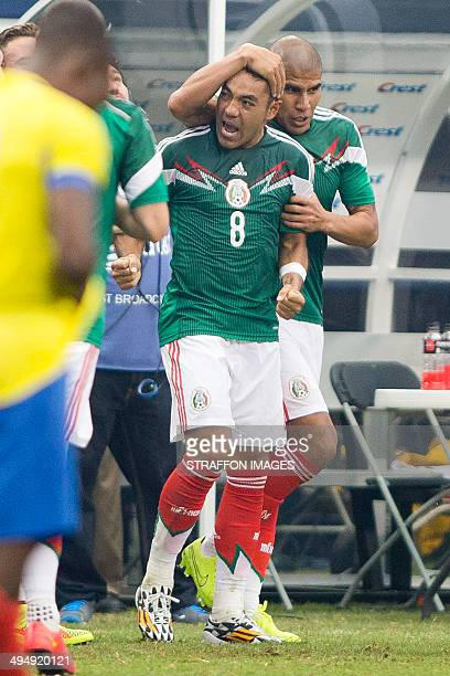 Marco Fabian of Mexico celebrates with Carlos Salcido a scored goal the second of the match during the International Friendly match between Mexico...