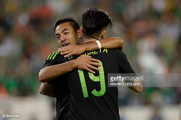 Marco Fabian of Mexico celebrates with his teammate Oribe Peralta his goal against New Zeland during the friendly match between the Mexican national...