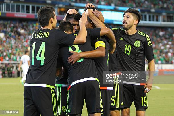 Marco Fabian of Mexico celebrates with teammates after scoring his team's second goal during the International Friendly Match between Mexico and New...