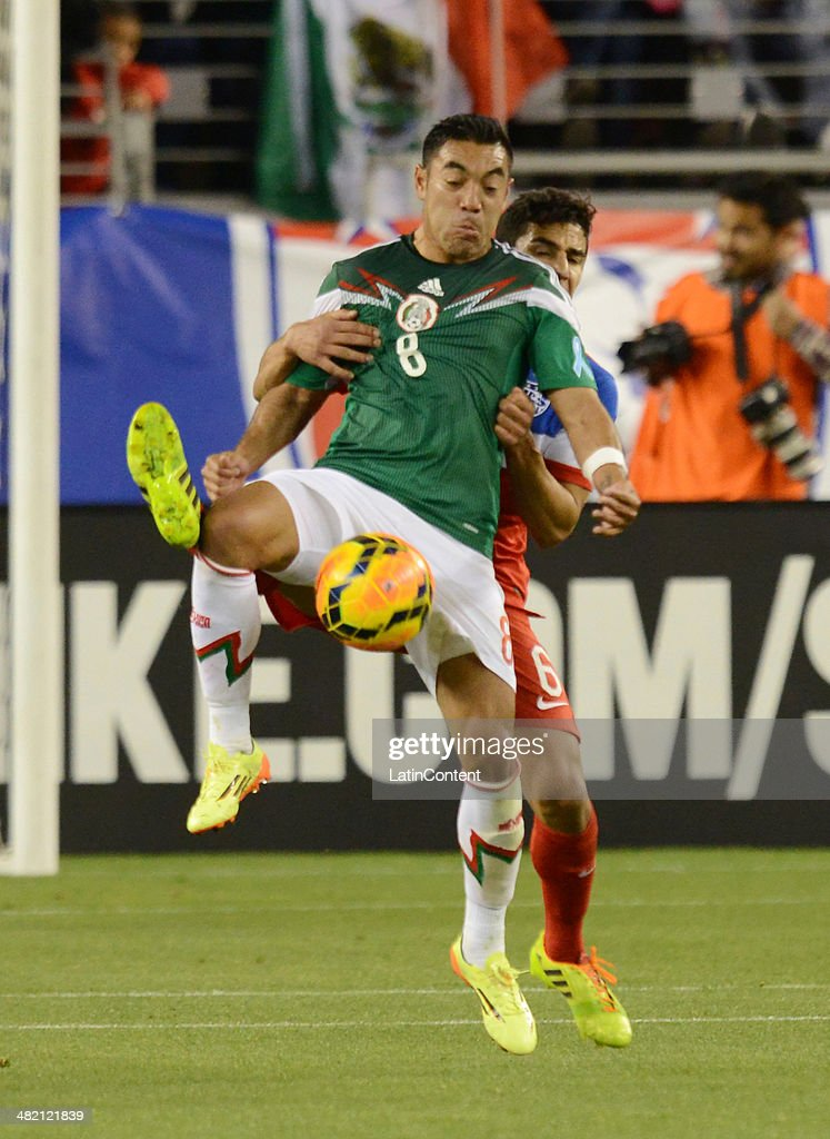 Marco Fabian of Mexico fights for the ball with Tony Beltran of the US during a friendly match between USA and Mexico previous to the FIFA World Cup...