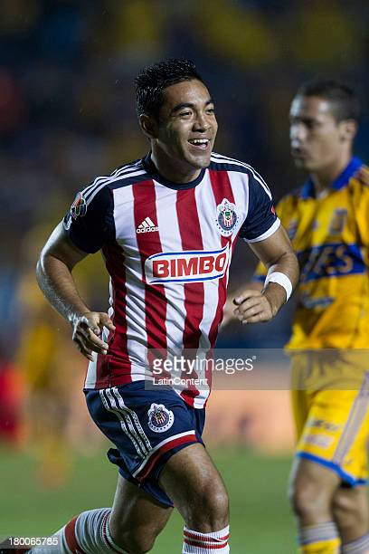 Marco Fabián of Chivas celebrates after scoring during a match between Tigres and Chivas as part of Apertura 2013 Tournament at Universitario Stadium...