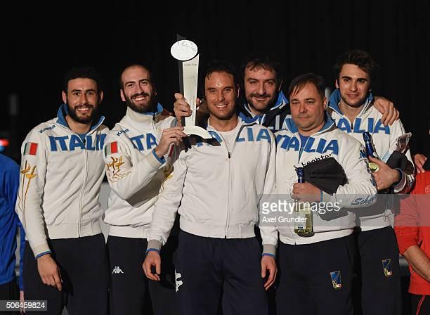 Marco Fichera Andrea Santarelli Paolo Pizzo Assistent Luigi Mazzone Coach Dario Chiado and Enrico Garozzo of Italy celebrate on the podium after...