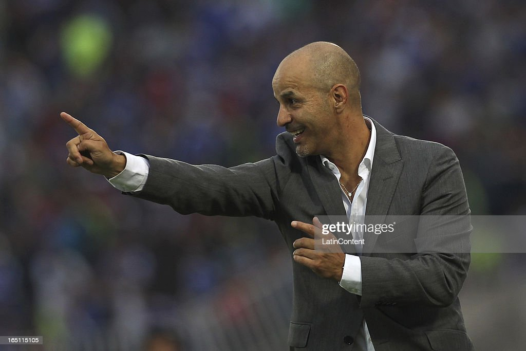 Marco Figueroa, coach of Cobreloa, shouts instructions to his players during a match between Universidad de Chile and Cobreloa as part of the Torneo Transicion 2013 at Estadio Nacional on March 30, 2013 in Santiago, Chile.