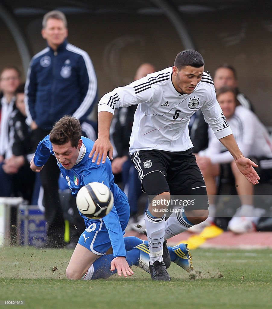 Marco Fossati (L) of Italy competes for the ball with Philipp Hofmann of Germany during U20 International Friendly match between Italy and Germany at Stadio Cosimo Puttilli on February 6, 2013 in Barletta, Italy.