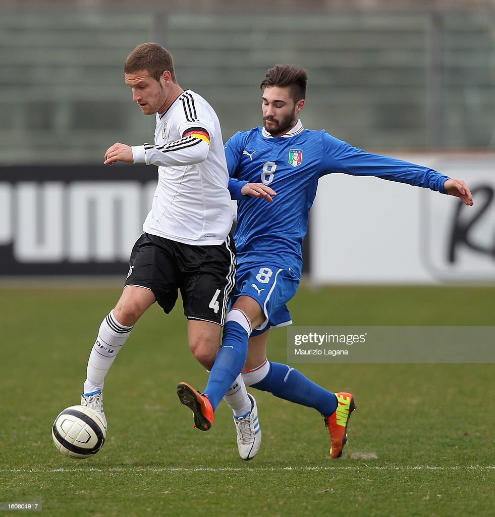 Marco Fossati (R) of Italy competes for the ball with <a gi-track='captionPersonalityLinkClicked' href=/galleries/search?phrase=Shkodran+Mustafi&family=editorial&specificpeople=5006425 ng-click='$event.stopPropagation()'>Shkodran Mustafi</a> of Germany during U20 International Friendly match between Italy and Germany at Stadio Cosimo Puttilli on February 6, 2013 in Barletta, Italy.