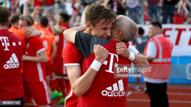 Marco Friedl of Bayern celebrates after winning the U19 German Championship Semi Final second leg match between FC Schalke and FC Bayern at Lohrheide...