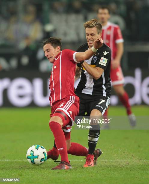 Marco Friedl of Bayern Muenchen and Patrick Herrmann of Borussia Moenchengladbach battle for the ball during the Bundesliga match between Borussia...