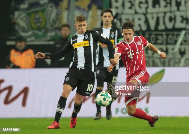 Marco Friedl of Bayern Muenchen and Thorgan Hazard of Borussia Moenchengladbach battle for the ball during the Bundesliga match between Borussia...