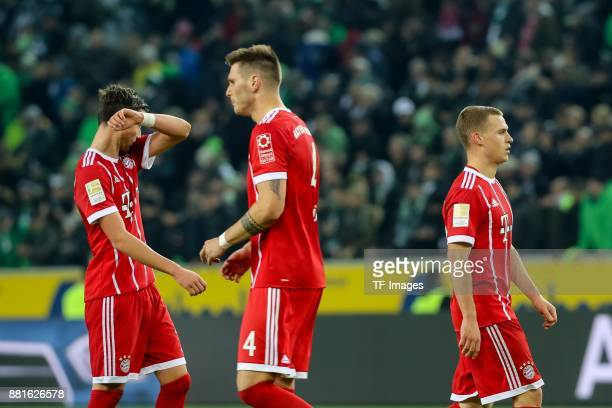 Marco Friedl of Bayern Muenchen Niklas Suele of Bayern Muenchen Joshua Kimmich of Bayern Muenchen looks dejected during the Bundesliga match between...