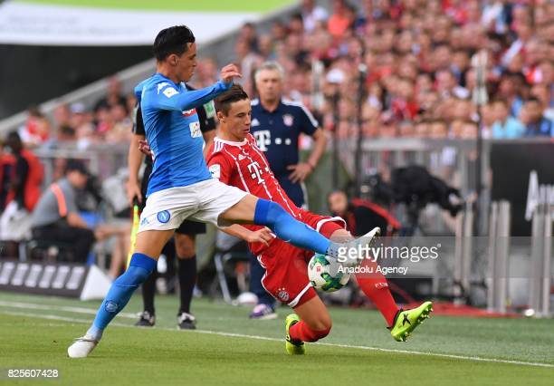 Marco Friedl of Bayern Munich and Jose Maria Callejon Bueno of Napoli vie for the ball during the Audi Cup soccer match between FC Bayern Munich and...