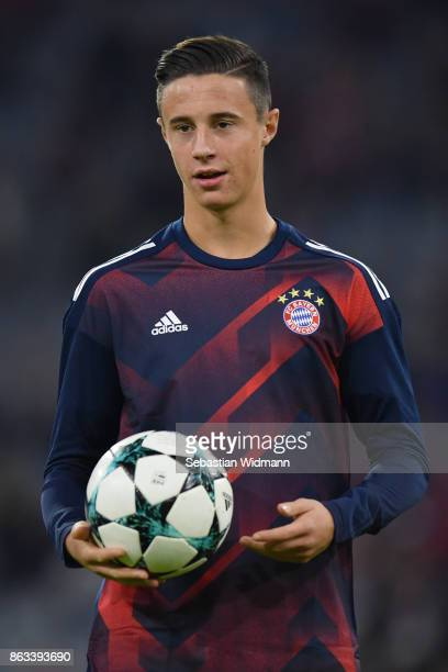Marco Friedl of FC Bayern Muenchen holds a ball during warum up prior to the UEFA Champions League group B match between Bayern Muenchen and Celtic...