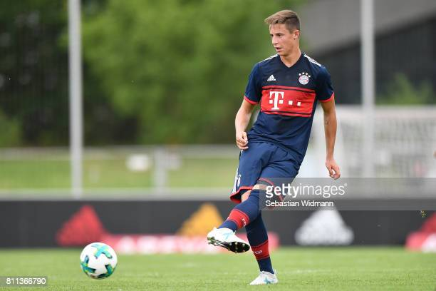 Marco Friedl of FC Bayern Muenchen plays the ball during the preseason friendly match between FSV ErlangenBruck and Bayern Muenchen at Adi Dassler...