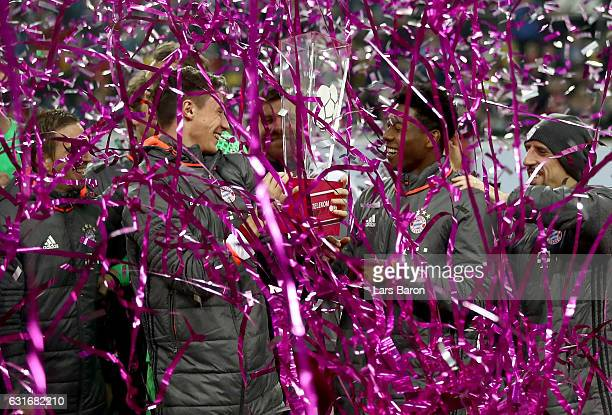 Marco Friedl of Muenchencelebrates with David Alaba after winning the Telekom Cup 2017 final between Bayern Muenchen and FSV Mainz 05 at EspritArena...