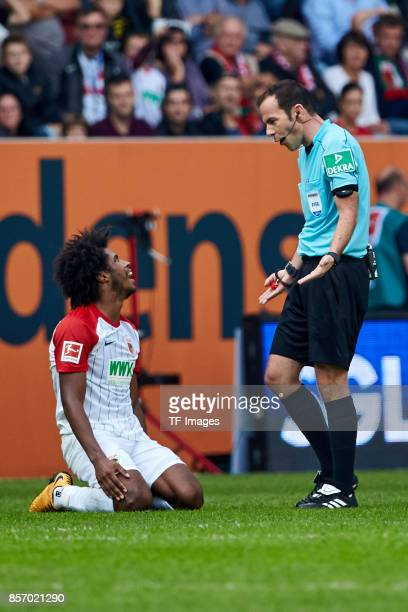 Marco Fritz speak with Francisco da Silva Caiuby of Augsburg during the Bundesliga match between FC Augsburg and Borussia Dortmund at WWKArena on...