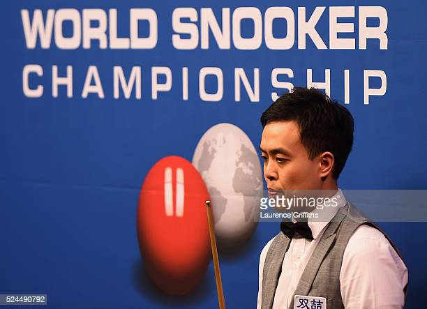 Marco Fu from Hong Kong in action during his quarter final match against Barry Hawkins of England on day eleven of the World Championship Snooker at...