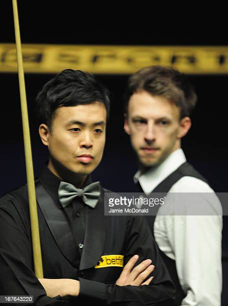 Marco Fu in action during his second round match against Judd Trump during the Betfair World Snooker Championship at the Crucible Theatre on April 27...
