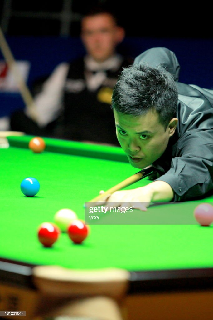 <a gi-track='captionPersonalityLinkClicked' href=/galleries/search?phrase=Marco+Fu&family=editorial&specificpeople=221154 ng-click='$event.stopPropagation()'>Marco Fu</a> of China plays a shot in the match against Kyren Wilson of England on day four of the 2013 World Snooker Shanghai Master at Shanghai Grand Stage on September 19, 2013 in Shanghai, China.