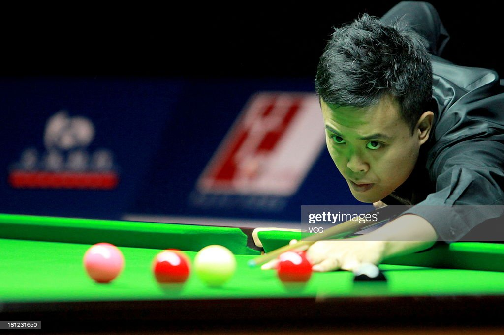 Marco Fu of China plays a shot in the match against Kyren Wilson of England on day four of the 2013 World Snooker Shanghai Master at Shanghai Grand Stage on September 19, 2013 in Shanghai, China.