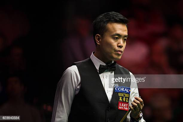 Marco Fu of Chinese Hong Kong chalks the cue during the first round match against Ryan Day of Wales on day two of Coral Northern Ireland Open 2016 at...
