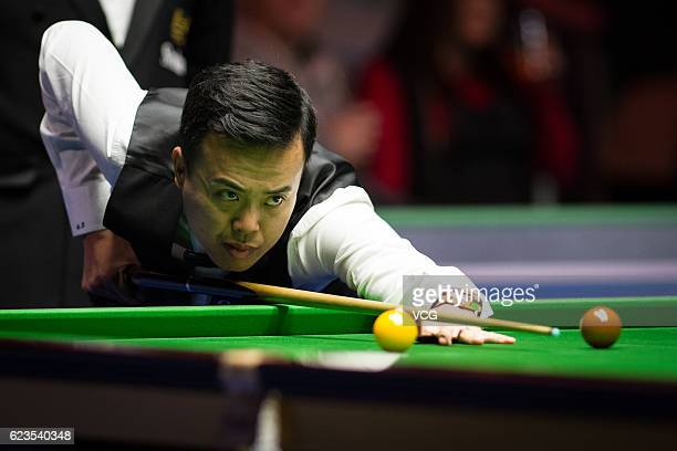 Marco Fu of Chinese Hong Kong plays a shot during the first round match against Ryan Day of Wales on day two of Coral Northern Ireland Open 2016 at...