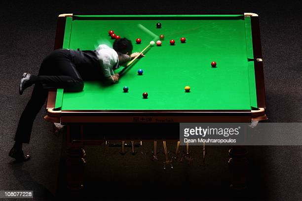 Marco Fu of Hong Kong in action against Ding Junhui of China in the Final of The Ladbrokesmobile Masters on Day 8 at Wembley Arena on January 16 2011...
