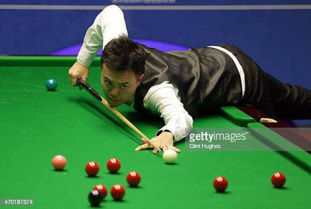 Marco Fu of Hong Kong in action against Jimmy Robertson of England during day one of the Betfred World Snooker Championship at Crucible Theatre on...