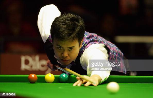 Marco Fu of Hong Kong in action during his first round match against Ding Junhui of China during The Masters Snooker Tournament at Wembley Conference...