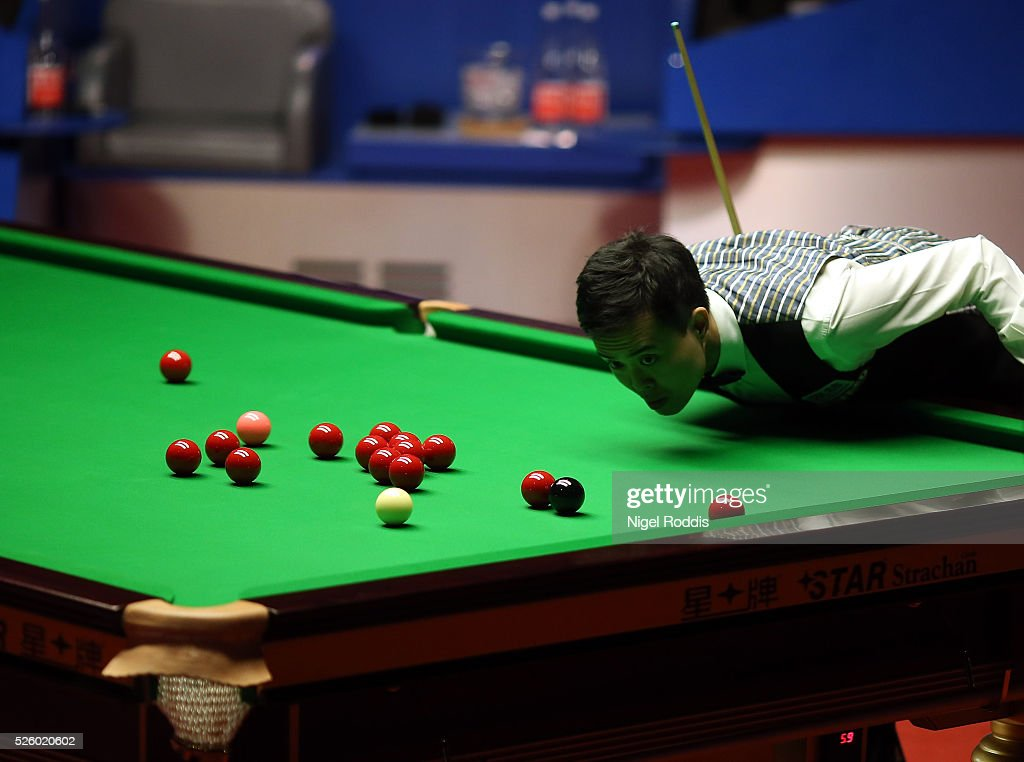 Marco Fu of Hong Kong in action during his semi final match against Mark Selby of England on day fourteen of the World Championship Snooker at Crucible Theatre on April 29, 2016 in Sheffield, England.